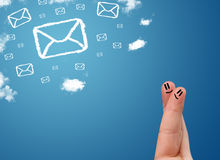 Happy smiley fingers looking at mail icons made out of clouds. Happy cheerful smiley fingers looking at mail icons made out of clouds royalty free stock photo