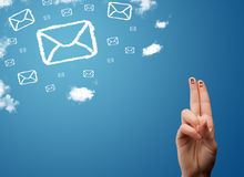 Happy smiley fingers looking at mail icons made out of clouds. Happy cheerful smiley fingers looking at mail icons made out of clouds Stock Photos