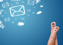 Happy smiley fingers looking at mail icons made out of clouds. Happy cheerful smiley fingers looking at mail icons made out of clouds Stock Image