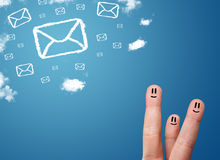 Happy smiley fingers looking at mail icons made out of clouds. Happy cheerful smiley fingers looking at mail icons made out of clouds Stock Images
