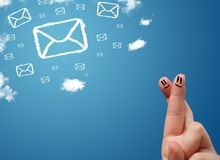 Happy smiley fingers looking at mail icons made out of clouds. Happy cheerful smiley fingers looking at mail icons made out of clouds royalty free stock image