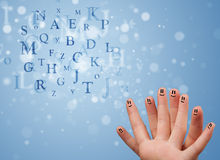 Happy smiley fingers looking at mixture of bokeh letters Royalty Free Stock Photos