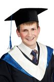Happy smiley graduate boy. Portrait of Young smiley graduate student in cloak isolated Stock Images
