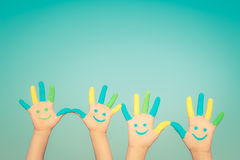 Happy smiley hands. Happy family with smiley on hands against blue summer sky background Stock Image
