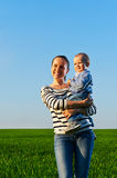 Happy and smiley mother with her little son Stock Image