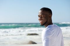 Happy smiling african american man at the beach Stock Photography