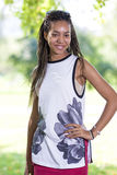 Happy Smiling African American Teenage Girl in Casual Clothing Posing Outside in Park. Stock Photos