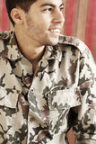 Happy smiling arab egyptian young man in military suit royalty free stock photos