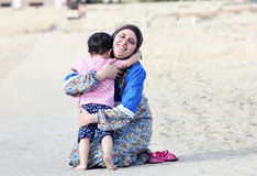 Happy smiling arab muslim mother hug her baby girl stock photos