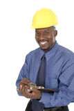 Happy Smiling Architect Engineer 1. Smiling architect, engineer, or supervisor in yellow hardhat holding a clipboard and pen Stock Photo