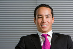Happy smiling asian business man Stock Photo