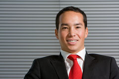 Happy smiling asian business man Royalty Free Stock Photos