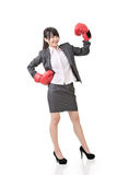 Happy smiling asian business woman with red boxing glove Stock Photos