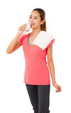 Happy smiling asian woman in fitness wear with bottle of water. Royalty Free Stock Photos
