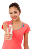 Happy smiling asian woman in fitness wear with bottle of water. Stock Photography