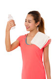 Happy smiling asian woman in fitness wear with bottle of water. Royalty Free Stock Images