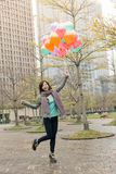 Happy smiling Asian woman holding balloons. At street, Taipei, Taiwan, Asia Royalty Free Stock Photography