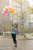 Happy smiling Asian woman holding balloons. At street, Taipei, Taiwan, Asia Royalty Free Stock Photos