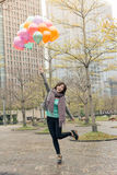 Happy smiling Asian woman holding balloons. At street, Taipei, Taiwan, Asia Stock Image