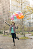 Happy smiling Asian woman holding balloons. At street, Taipei, Taiwan, Asia Stock Photography