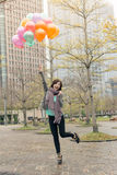 Happy smiling Asian woman holding balloons. At street, Taipei, Taiwan, Asia Royalty Free Stock Images