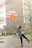 Happy smiling Asian woman holding balloons Royalty Free Stock Photos