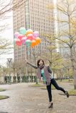 Happy smiling Asian woman holding balloons Royalty Free Stock Photography