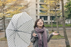 Happy smiling Asian woman holding an umbrella Stock Image