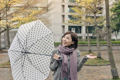 Happy smiling Asian woman holding an umbrella Royalty Free Stock Images