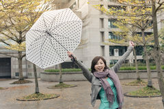 Happy smiling Asian woman holding an umbrella Stock Photos