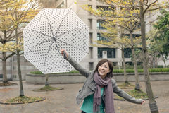 Happy smiling Asian woman holding an umbrella Royalty Free Stock Photo