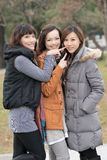 Happy smiling Asian women in the park Royalty Free Stock Photography