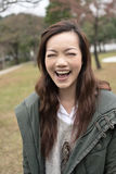 Happy smiling Asian young woman in the park Royalty Free Stock Photography