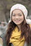 Happy smiling Asian young woman in the park Royalty Free Stock Images