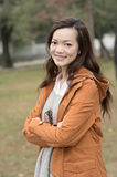 Happy smiling Asian young woman in the park Stock Photos
