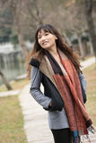 Happy smiling Asian young woman in the park Royalty Free Stock Photo