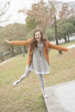 Happy smiling Asian young woman in the park Royalty Free Stock Photos