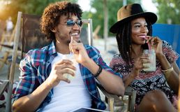 Happy smiling attractive young couple on date, having fun together. Happy smiling attractive young couple on date royalty free stock photos