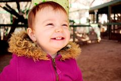 Happy Smiling Baby. A baby girl smiling really big Royalty Free Stock Photography