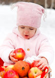 Happy smiling baby with apple in winter day Stock Photo