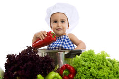 Happy smiling baby chef in pot. Isolated Royalty Free Stock Photo