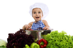 Happy smiling baby chef with vegetables Royalty Free Stock Photo