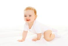 Happy smiling baby crawls on white background Royalty Free Stock Photo
