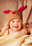 Happy smiling baby dressed in christmas deer hat Royalty Free Stock Photography