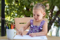 Happy Smiling Baby Girl Drawing Pictures stock photos