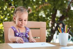 Happy Smiling Baby Girl Drawing Pictures royalty free stock photos