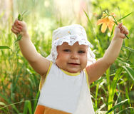 Happy smiling baby girl showing hands up Royalty Free Stock Photos
