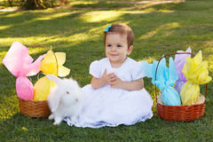 Happy smiling  baby girl with white rabbit and  Easter chocolate Stock Images