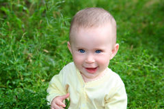 Happy smiling baby in grass Stock Image