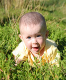 Happy smiling baby in grass Stock Photos